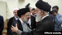 ابراهیم رئیسی در کنار علی خامنهای