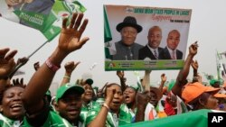 Supporters of Nigeria President Goodluck Jonathan, sing slogans, during an election campaign rally, at Tafawa Balewa Square in Lagos, Nigeria, Thursday, Jan. 8, 2015.