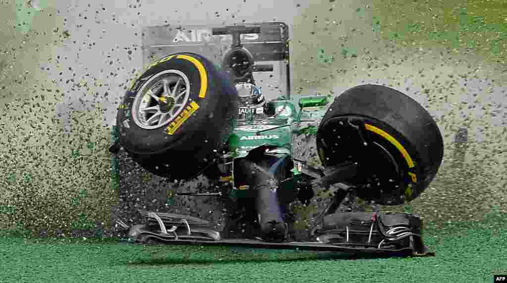 The car of Caterham-Renault driver Kamui Kobayashi of Japan veers off the track during an accident at the start of the Formula One Australian Grand Prix in Melbourne, Australia, March 16, 2014.