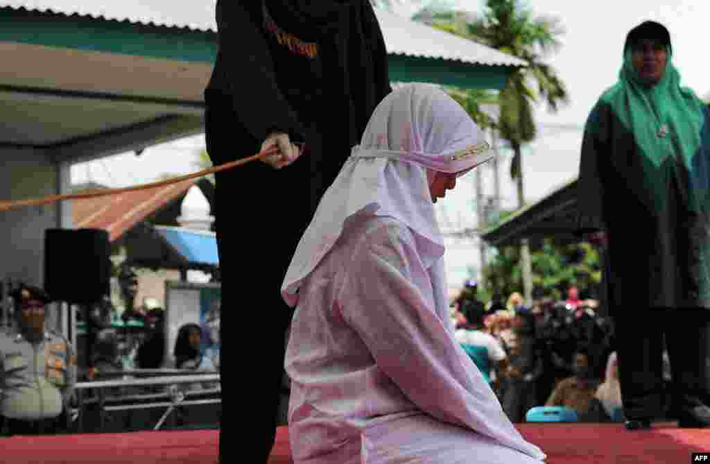One of four Acehnese teens gets whipped for spending time in close proximity with her boyfriend, which is against Sharia law, in Aceh.