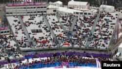 The spectator stands are seen half-filled at the Rosa Khutor Extreme Park during the 2014 Sochi Winter Olympics, Feb. 9, 2014.