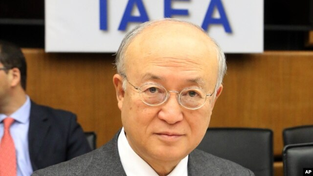 Director General of the International Atomic Energy Agency, IAEA, Yukiya Amano of Japan waits for the start of the IAEA board of governors meeting at the International Center in Vienna, Austria, March 3, 2014.