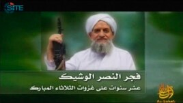 FILE - A photo of Al Qaeda's new leader, Egyptian Ayman al-Zawahiri, is seen in this still image taken from a video released on Sept.12, 2011.