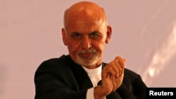 FILE - Afghan president-elect Ashraf Ghani speaks during an event in Kabul, Sept. 22, 2014.