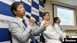 Jun Takahashi, left, professor at Kyoto University's Centre for iPS Cell Research and Application, attends a news conference in Kyoto, Japan, July 30, 2018.