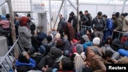 Migranti u privremenom kampu u selu Idomeni, na granici sa Makedonijom