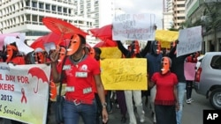 Masked sex workers march through the streets to demand access to government services, in Nairobi, Kenya, March 6, 2012.