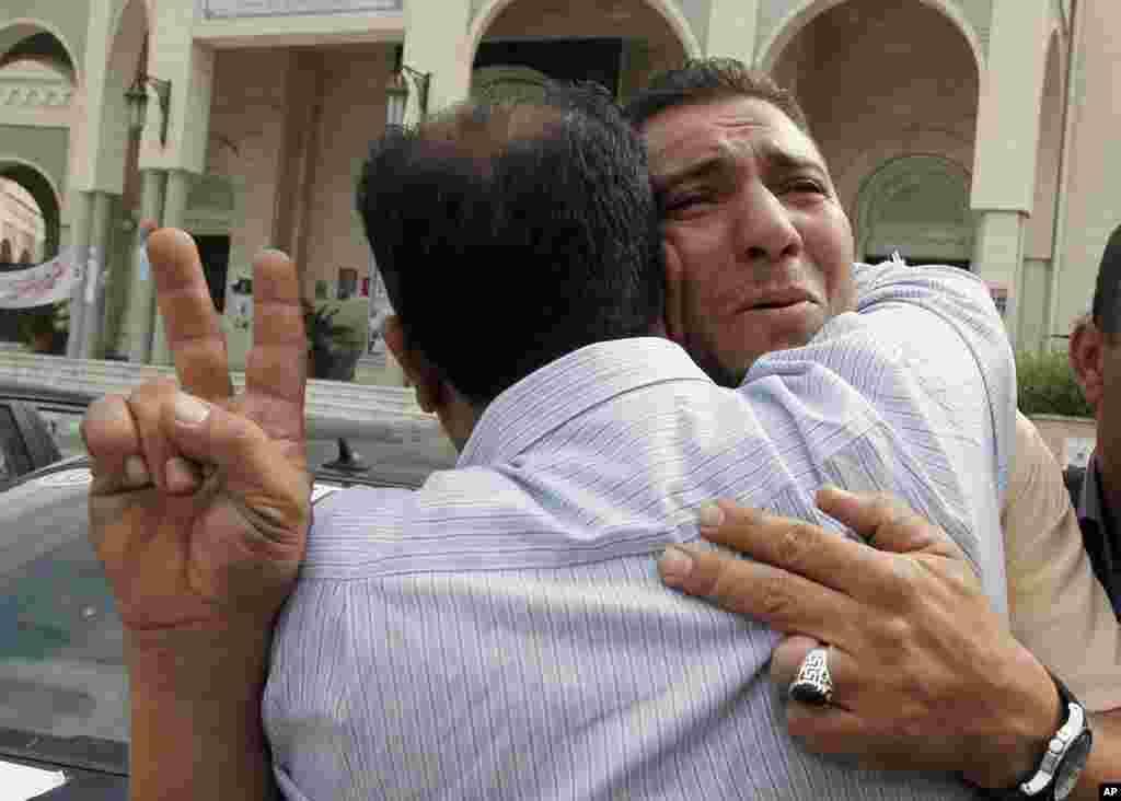 Libyans react to Moammar Gadhafi's death in Tripoli. (AP)