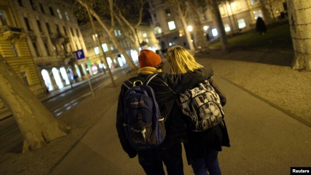 Same-sex couple Mima Simic and Marta Sisak walk in Zagreb, Croatia, Nov. 26, 2013.