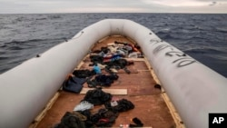 FILE - Migrants' personal belongings lie in a rubber boat after the people were rescued by aid workers of the Spanish NGO Proactiva Open Arms, 60 miles north of Al-Khums, Libya, Feb. 18, 2018. The migrants had left Libya in an effort to reach European soil.