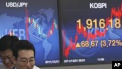 File - Currency traders react in front screens at the Korea Exchange Bank headquarters in Seoul, South Korea.
