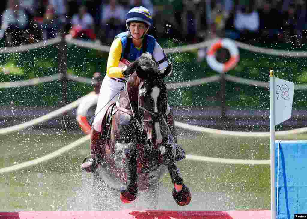 Sweden's Linda Algotsson rides La Fair as she competes in the Eventing Cross Country equestrian event in Greenwich Park.