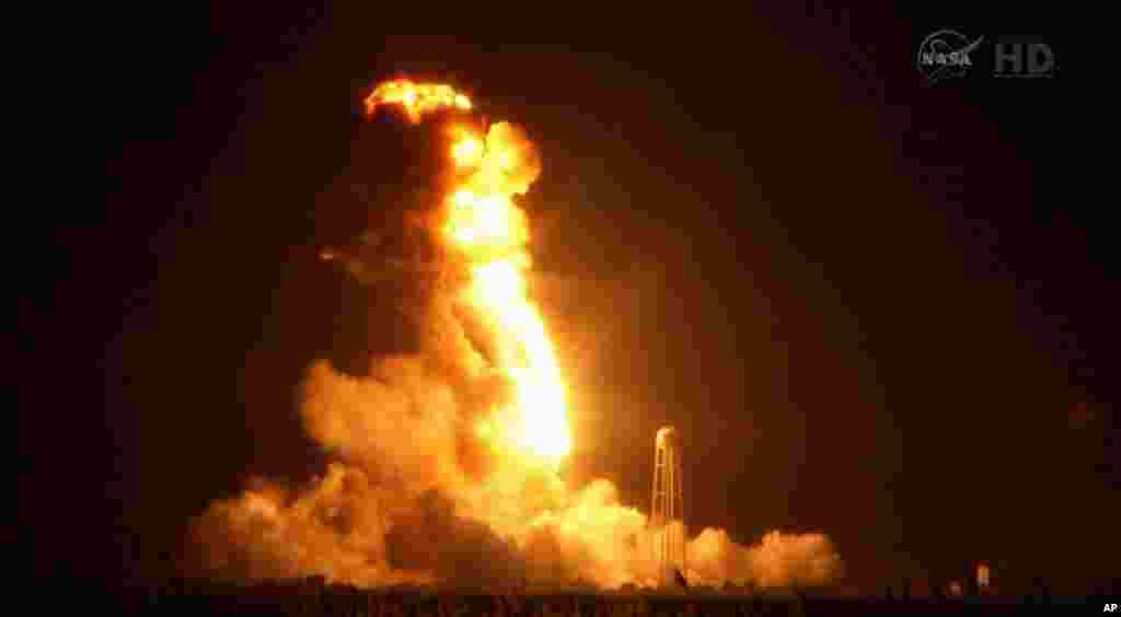 This image taken from video provided by NASA TV shows Orbital Sciences Corp.'s unmanned rocket blowing up over the launch complex at Wallops Island, Va., just six seconds after liftoff. The company says no one was believed to be hurt and the damage appeared to be limited to the facilities, Oct. 28, 2014.