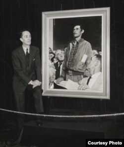 Norman Rockwell standing in front of his painting Freedom of Speech at Hecht's Department Store, Washington, DC, inaugural stop of the Four Freedoms War Bond Tour, 1943. (Norman Rockwell Museum Collection)