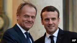 French President Emmanuel Macron (right) welcomes European Council President Donald Tusk at the Elysee presidential Palace in Paris, May 17, 2017.