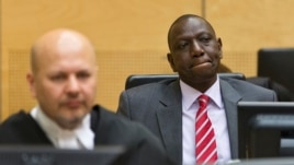 Kenya's Deputy President William Ruto (R) reacts as he sits in the courtroom before his trial at the ICC in The Hague in this September 10, 2013, file photo.
