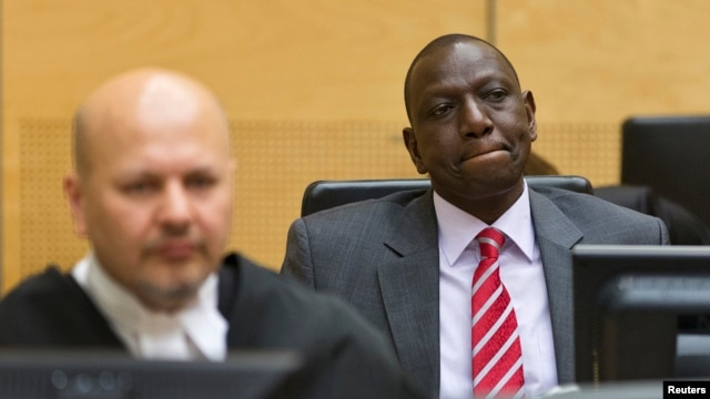 FILE - Kenya's Deputy President William Ruto (R) reacts as he sits in the courtroom before his trial at the International Criminal Court (ICC) in The Hague, Sept. 10, 2013.