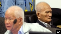 In this photo released by the Extraordinary Chambers in the Courts of Cambodia, Khieu Samphan, left, former Khmer Rouge head of state, and Nuon Chea, right, who was the Khmer Rouge's chief ideologist and No. 2 leader, sit in the court hall before they made closing statements at the U.N.-backed war crimes tribunal in Phnom Penh, Cambodia, Thursday, Oct. 31, 2013.
