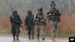 U.S. and South Korean army soldiers march during their military exercise in Paju near the border with North Korea, South Korea, April 25, 2013.