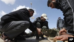 Anti-Gadhafi rebels prepare anti-aircraft ammunition in Ras Lanouf, eastern Libya, March 8, 2011