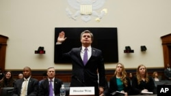 FBI Director Christopher Wray is sworn in during a House Judiciary hearing on Capitol Hill in Washington, Dec. 7, 2017.