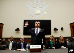 FILE - FBI Director Christopher Wray is sworn in during a House Judiciary hearing on Capitol Hill in Washington, Thursday, Dec. 7, 2017.