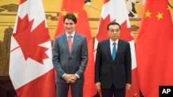 加拿大總理杜魯多(左)與中國總理李克強(右)資料照。