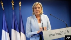 FILE - French far-right leader Marine Le Pen is seen speaking in Nanterre, outside Paris, Nov. 9, 2016. Fillon will likely face off with Le Pen at polls in April.