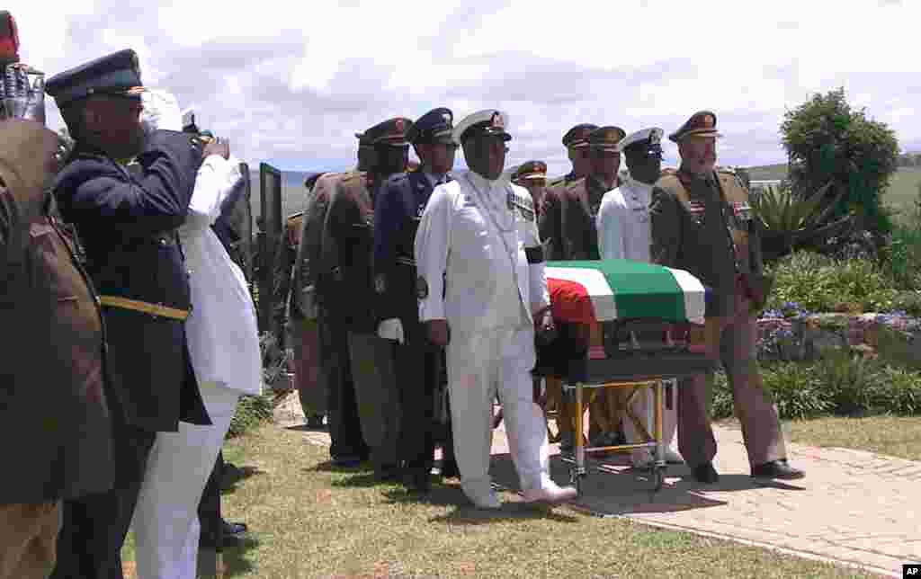 In this video frame grab, military officers escort former South African President Nelson Mandela's casket as it arrives at his burial site following his funeral service in Qunu, Dec. 15, 2013.