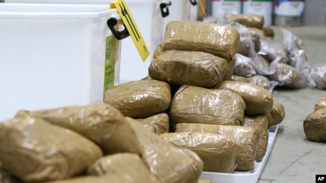 FILE - Packages containing methamphetamine are stacked in a warehouse in Melbourne.