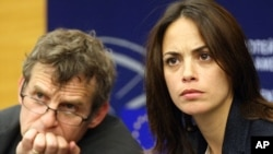 French actress Berenice Bejo, right, and Belgian director Lucas Belvaux address the media at the European parliament in Strasbourg, eastern France, June 11, 2013, after their meeting with EU officials asking that audiovisual services be kept off the table during upcoming EU-US free-trade negotiations.