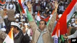 Supporters of Indian anti corruption activist Arvind Kejriwal, unseen, cheer at the formal launch of his political party 'Aam Aadmi Party (AAP)' in New Delhi, November 26, 2012.