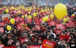 FILE - Protesters shout slogans during a rally against the impeached South Korean President Park Geun-hye in downtown Seoul, South Korea, Dec. 17, 2016.