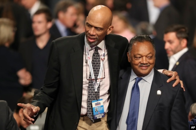 FILE - Former NBA basketball player Kareem Abdul-Jabbar stands with Jesse Jackson, Jr., before the third presidential debate at UNLV in Las Vegas, Oct. 19, 2016.