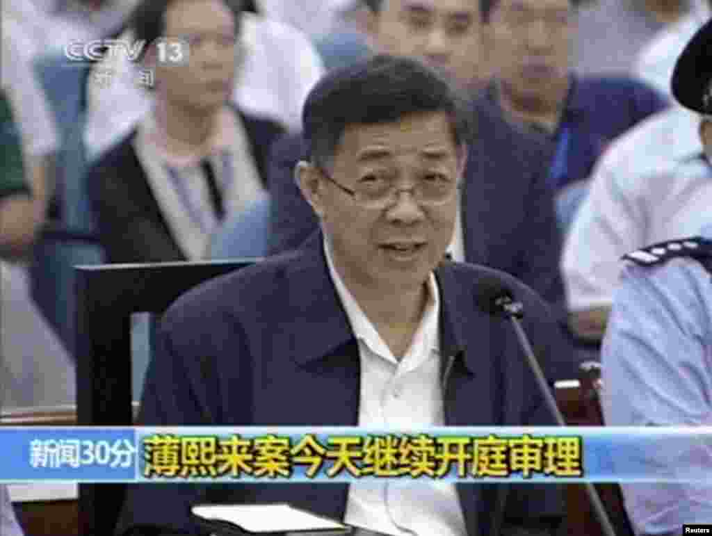 In this image taken from video, Bo Xilai addresses a court at Jinan Intermediate People's Court in eastern China's Shandong province, Aug. 24, 2013.
