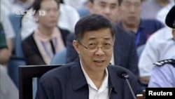 In this image taken from video, former Chinese politician Bo Xilai addresses a court at Jinan Intermediate People's Court in eastern China's Shandong province, Aug. 24, 2013.