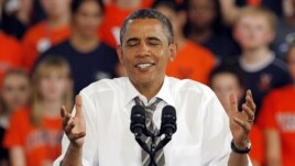 President Barack Obama shrugs during a rally in Charlottesville, Virginia, Aug. 29, 2012.