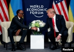 FILE - U.S. President Donald Trump meets President Paul Kagame of Rwanda during the World Economic Forum annual meeting in Davos, Switzerland, Jan. 26, 2018.