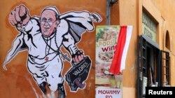 El papa Francisco fue pintado como un súper héroe en una pared cerca al Vaticano.