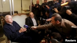 Former Lebanese information minister Michel Samaha (L) speaks to the media at his home after being released in Beirut, Lebanon, Jan. 14, 2016.