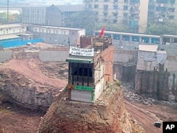 "This ""nail house"" in Chongqing, China, is a dramatic example of how some property owners can stubbornly refuse to sell to developers - sometimes with dramatic consequences."