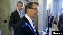 U.S. Senator Gary Peters, a Michigan Democrat, speaks with reporters at the U.S. Capitol after confirming his support for the international nuclear deal with Iran, Sept. 8, 2015.