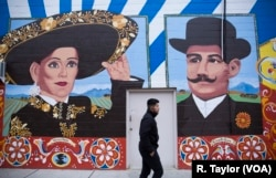 "An East Boston mural celebrates Mexican-born activist Veronica Robles and Sicilian entrepreneur Carmello Scire, both immigrants to Boston. The artwork is part of the City of Boston's ""To Immigrants With Love"" project, which celebrates Boston's immigrants, old and new."