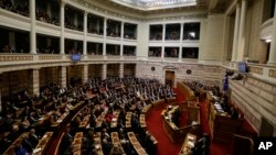 Greek lawmakers attend the third round of voting to elect a new Greek president at the Parliament in Athens, Dec. 29, 2014. Now a general elections is planned for January 25. (AP Photo/Thanassis Stavrakis)