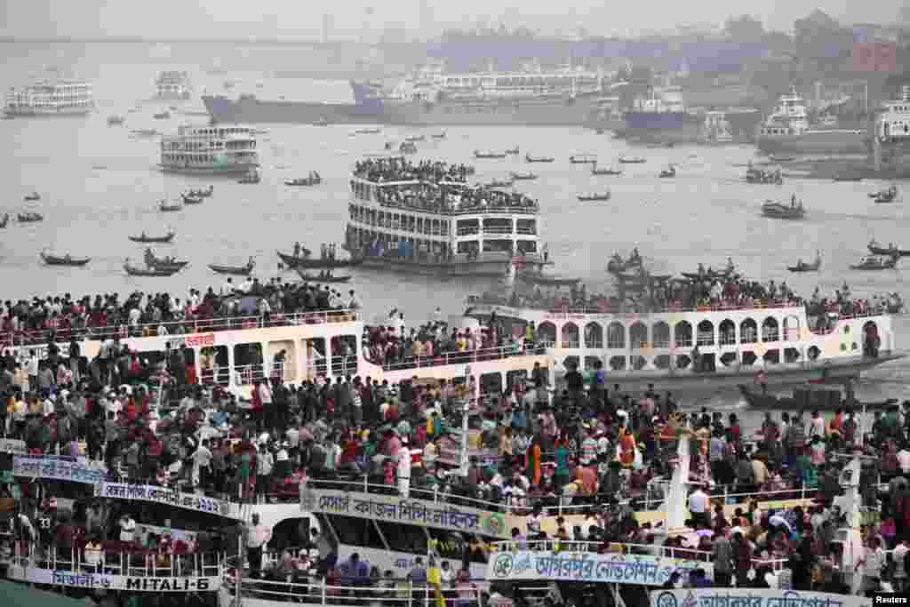 Overcrowded passenger boats are seen on the Buriganga River in Dhaka, Bangladesh. Millions of residents in Dhaka are travelling home from the capital city to celebrate Eid al-Adha on October 27, 2012.
