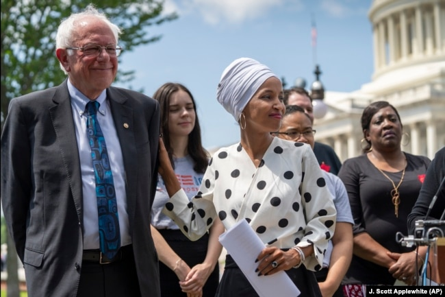 Democratic presidential candidate, Sen. Bernie Sanders, I-Vt., left, and Rep. Ilhan Omar, D-Minn., the sponsors of legislation to cancel all student loan debt, hold a news conference at the Capitol in Washington, Monday, June 24, 2019.