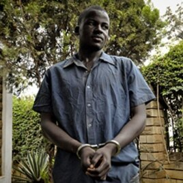 Enoch Nsubuga, killer of gay rights activist David Kato, standing in front of journalists at the Ugandan media center in Kampala, February 3, 2011 (file).