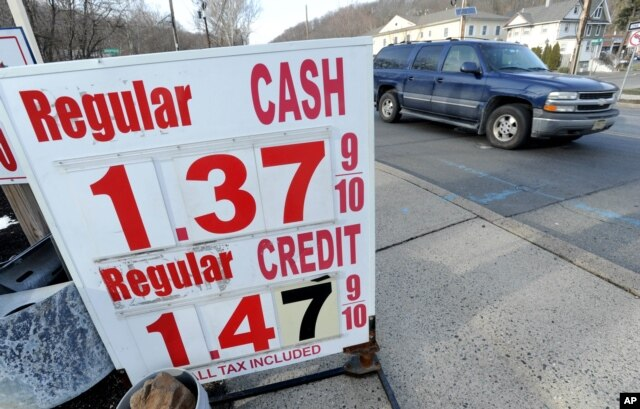 FILE - U.S. oil prices crashed below $27 dollars a barrel on Wednesday for the first time since 2003, caught in a broad slump across world financial markets. Gas is $1.39 per gallon in North Plainfield, N.J., Jan. 20, 2016.