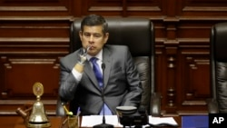 National Congress President Luis Galarreta presides over a special session on whether to initiate impeachment proceeding against the country's president, in Lima, Peru, Dec. 15, 2017. Lawmakers went onto to approve impeachment proceedings against President Pedro Pablo Kuczynski.