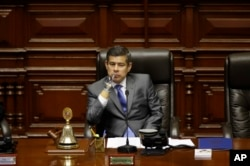 National Congress President Luis Galarreta presides over a special session on whether to initiate impeachment proceeding against the country's president, in Lima, Peru, Dec. 15, 2017. Lawmakers went onto to approve impeachment proceedings against Preside